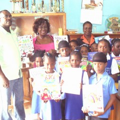 Deloris presented school children with books
